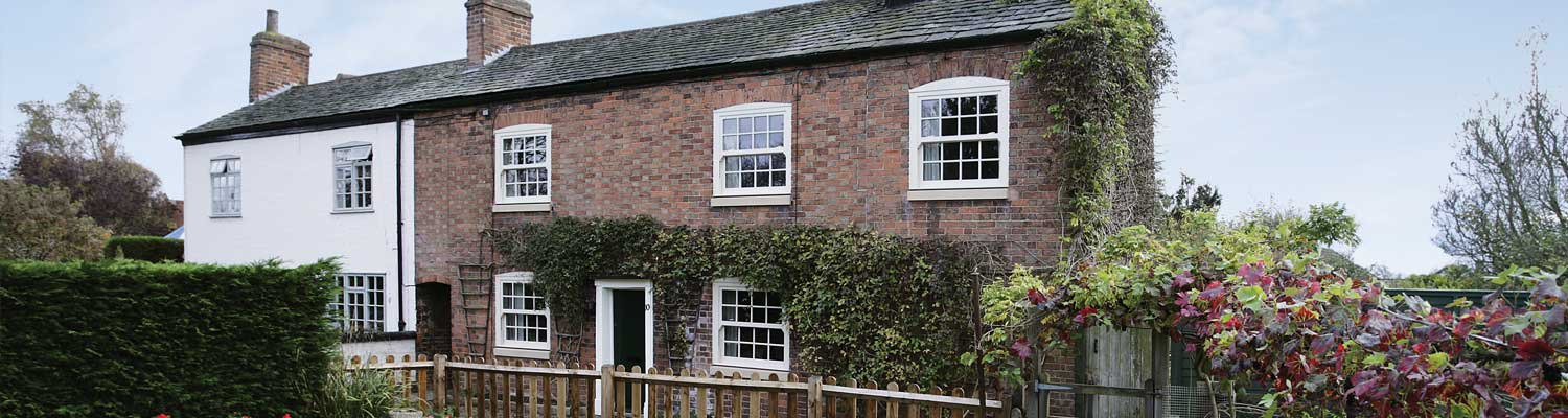 traditional upvc sash windows installed in a country cottage