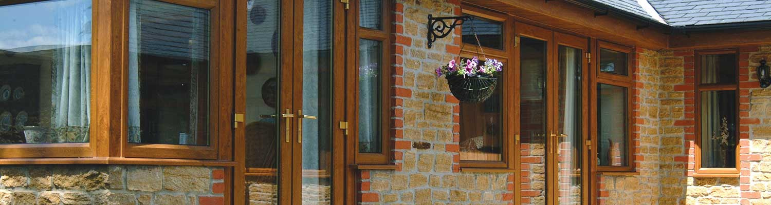 traditional style wood coloured upvc windows and doors