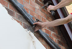 If necessary, tidy up any plaster above the marked lines.