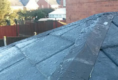 Using a high quality flash band, seal the ridge joints with a heat gun and install the ridge tiles.