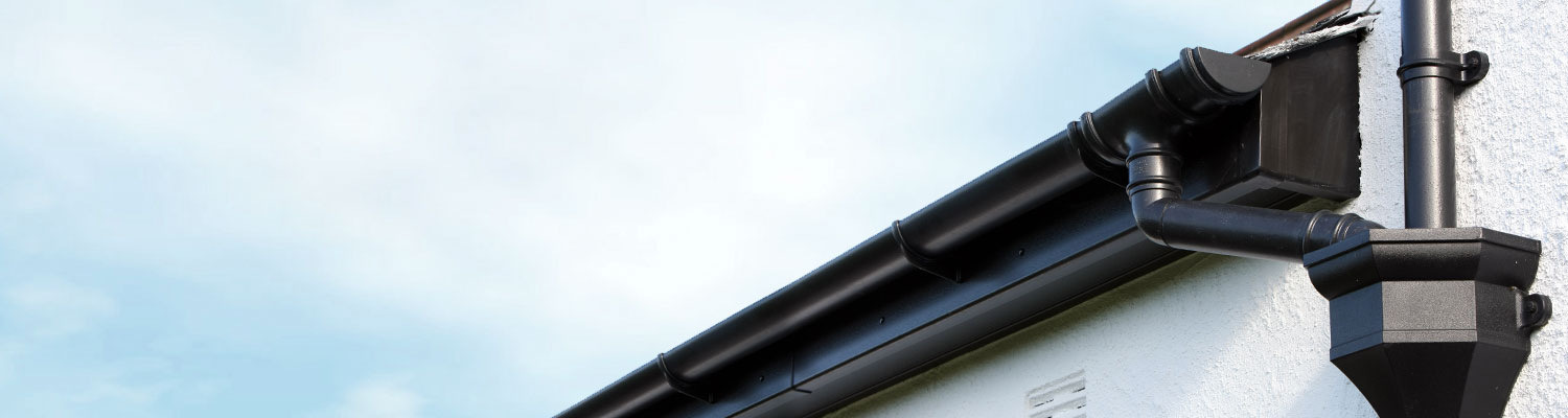 black guttering and black upvc fascia and soffits