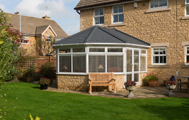 white upvc conservatory with tiled roof system