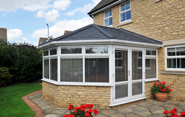 panoramic conservatory with white upvc windows and equinox tiled roof