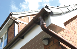 dark upvc guttering and white fascia and soffits