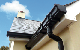 black upvc guttering and white fascia and soffits