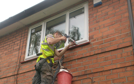 man installing second floor white upvc windows