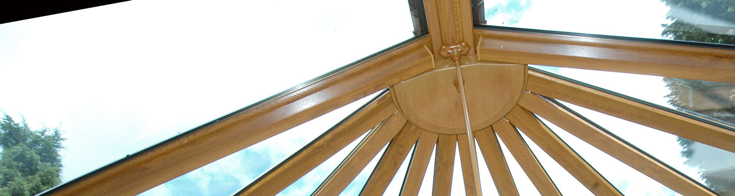 indoor view of a wood grain upvc conservatory roof