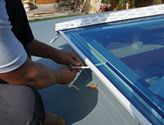 Fit the rafter and hip top caps using a nylon mallet, then ensuring the glass is positioned correctly, peel the remaining eaves beam seal tape film away and press glazing down to ensure contact with eaves tape.