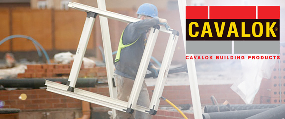 man carrying cavity closers on building site
